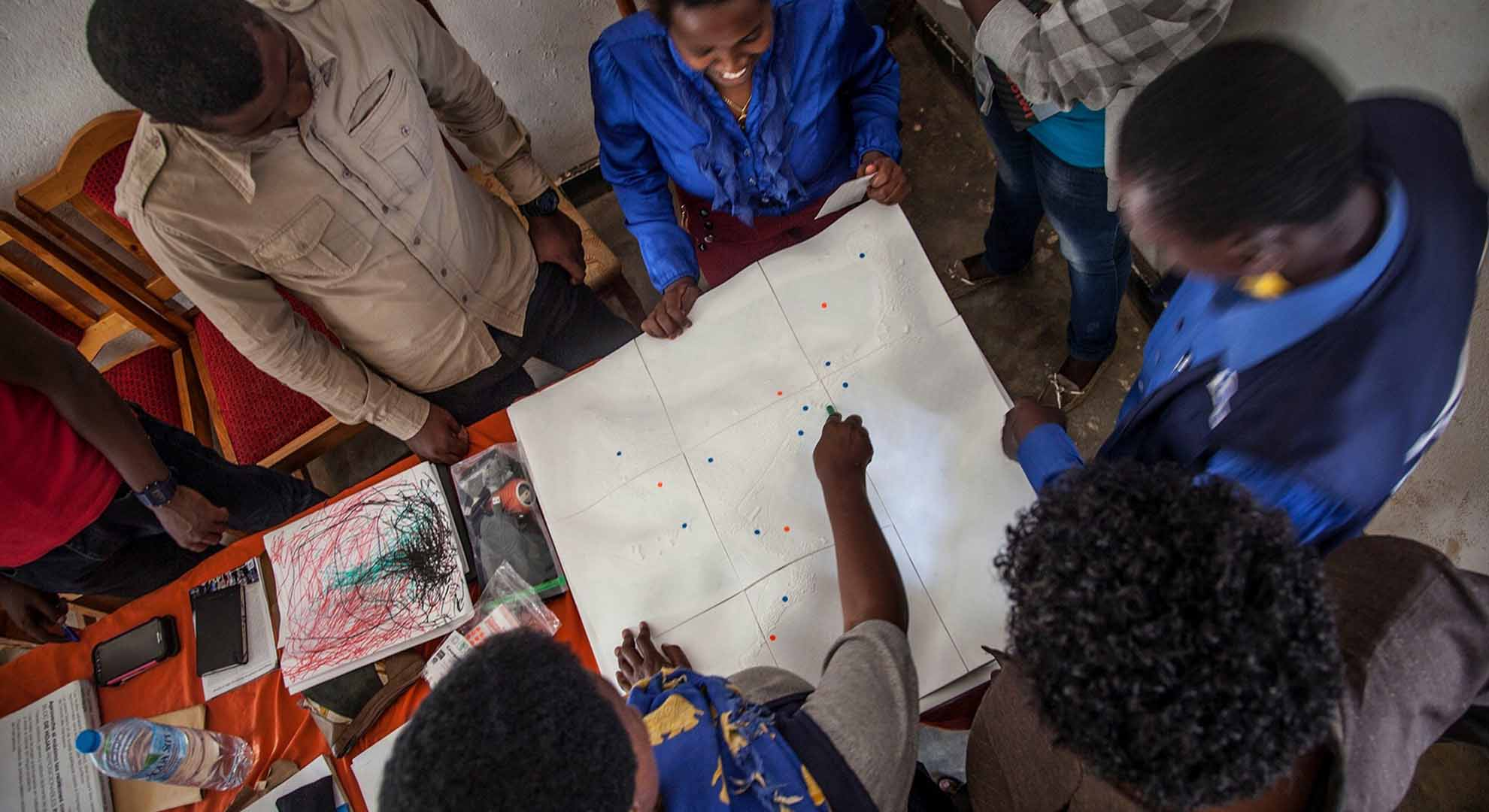 A participatory design session of neighbourhood improvements with people affected by climate-related forced migration.