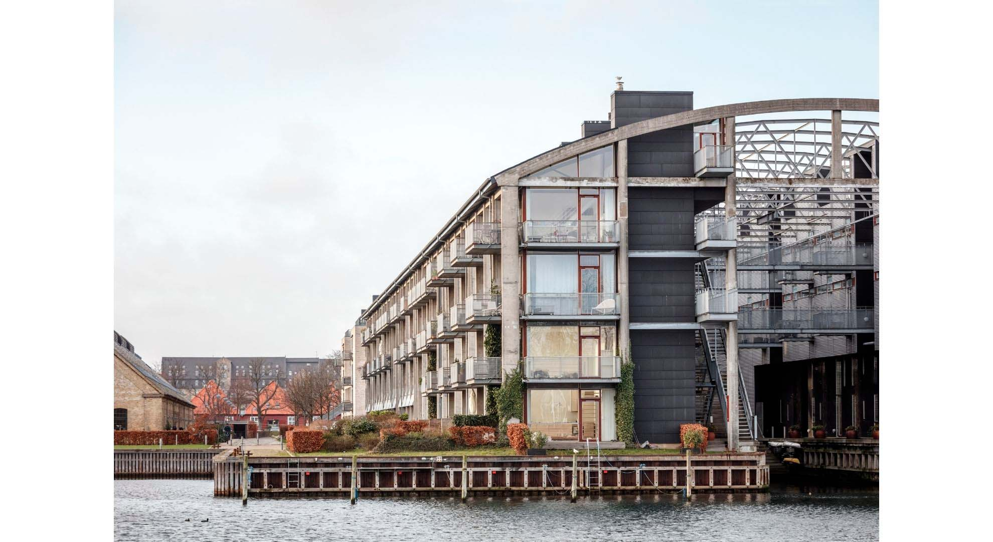 An adaptive reuse of a torpedo boat workshop for housing in Copenhagen.